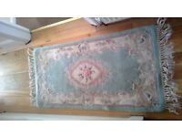 Chinese Rugs, x2, approx 4 feet by 2 feet. In the main green in colour