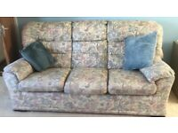 3 piece suite including 3 seater sofa, and two armchairs, one of which reclines