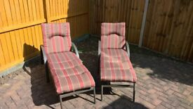 Pair of barely used adjustable sun loungers with detachable cushions