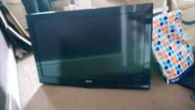 31 inch flat screen TV with wall mounting bracket