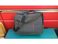 grey and orange laptop bag