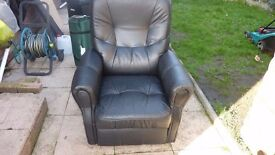 Recliner armchair in black leather