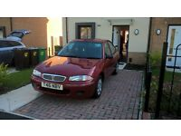 RED COLOUR ROVER IN AVERY GOOD CONDITION