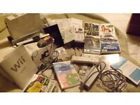 Nintendo Wii sports console white 7+ bundle .. with 7 games set up but never used mint cond