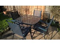 Garden Table and Chairs with matching Sun Loungers.