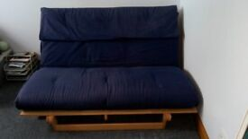 IKEA wooden slatted futon. Double size, washable cotton cover. Safety labels in place. Never used.