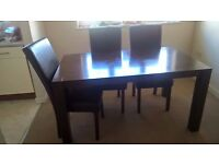 wooden dining table and 6 chairs given cause little damages for free