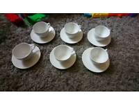 6 white cups and saucers