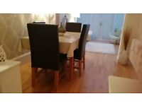 four oak/brown leather chairs originaly from Next in very good condition