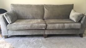 Grey sofa and matching footstool. Just over a year old and in perfect condition. 230cm x 95cm