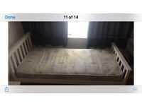 Single white wooden bed and mattress