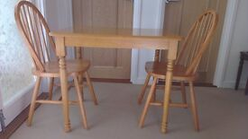 """TABLE & 2 CHAIRS, PINE COLOUR, GOOD CONDITION. TABLE MEASURES 34"""" X 26"""" X 30"""" H, LEGS ARE REMOVABLE"""