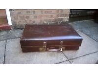 traditional vintage brown leather suitcase