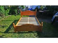Solid pine king-size bed.