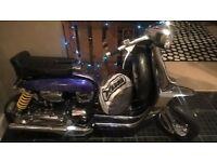 Customised 200cc Lambretta in black and purple and blue.Chromed customised paint,seats etc.