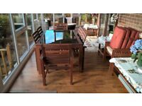 hardwood dining table and chairs iterior or exterior use.