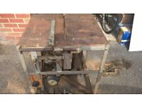 Electric saw table and compressor combined on wheels, vintage design.
