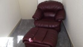 Leather armchair and footstool.