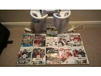 Nintendo Wii with 2 controllers, 11 games and 3 steering wheel covers