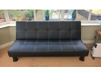 3 Seater Futon Sofa Bed in 3 Black Faux Leather.