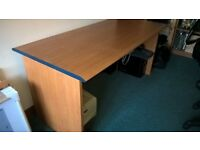 Large light wood effect office desk.