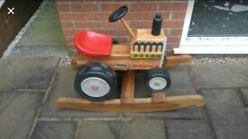 Hand made solid wood rocking tractor