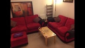 DFS sofa set 2 medium/large red sofas (one a sofa bed) and matching footstool