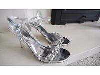 Size 4 silver heels with crystal design from Debenhams