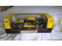 1 : 18 scale Anson Racing black and yellow Porsche 911 GT2 model car