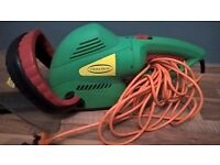 Large hedge trimmer with twist handle