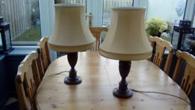 2 traditional walnut lamp bases with gold silk shades