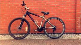 Two bikes and money your way for a decent mountain bike