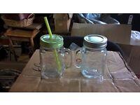 2 GLASS JARS ONE WITH STRAW