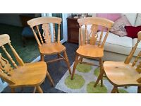 Four solid wooden kitchen/dining chairs for sale - £5 each or £15 for all four!