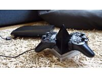 Playstation 3 (PS3) 500GB with 2 dual shock controllers charging station and 15 games