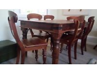 A used John-Lewis dining table with six chairs made of Indian hardwood.