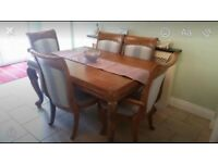 Heavy solid wood table and 6 chairs