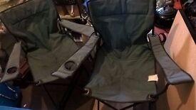 2 green folding chairs