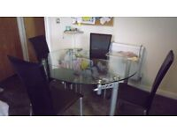 Glass Kitchen Table with four chairs. Excellent condition.