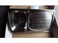 Brand new stainless steel kitchen sink with fittings.