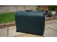 "Green hard shell suitcase 29"" x 23"" x 9"""