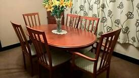 Extending dining table and chairs