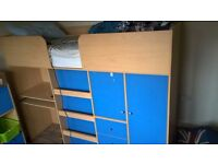 Boy's mid-sleeper single bed and matching cube shelf/cupboard unit