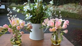 Very realistic Artificial flowers in vases and jugs