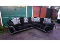 Black & grey corner sofa. Good condition. Can deliver.