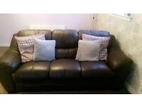 Brown leather 3 seater sofa and chair.