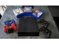 Playstation 4 with 14 games 4 controllers