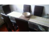6 seater glass dining table and chairs