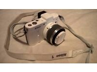 White Nikon 1 V1 1nikkor nikkor compact system camera with 10-30mm kit lens - very good condition