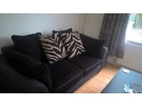 3 Seater Settee in black fabric complete with 4 Large scatter cushions